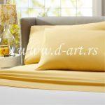 žuta posteljina od pamučnog satena
