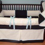 teget bela decija posteljina sa plavim masnicama